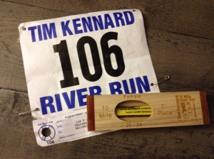 My race bib from this year's Tim Kennard River Run 10-miler and my third place female 20-24 award are shown. (Vanessa Junkin photo)