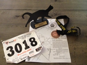The map for the Run for the Animals half marathon course is shown with my race bib, trophy and medal for finishing. (Vanessa Junkin photo)