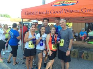 My friends and I pose with our winning growlers after the 3rd Wave Brewing Co. 5K. Someone at the race was able to take our photo.
