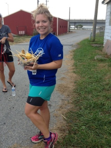 Here I am with my award — a basket of oyster-related items and an engraved knife — after the Skipjack Run 10K. (Veronica James photo)