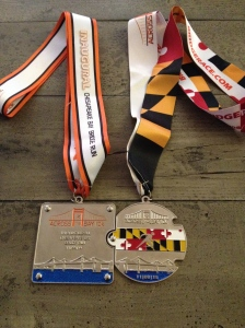 Here's how the 2014 and 2015 Across the Bay 10K medals interlock. (Vanessa Junkin photo)