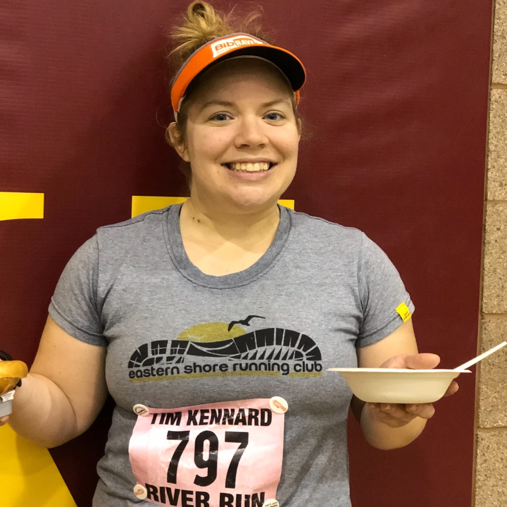 Vanessa Junkin poses with a bowl of food after the Tim Kennard River Run.