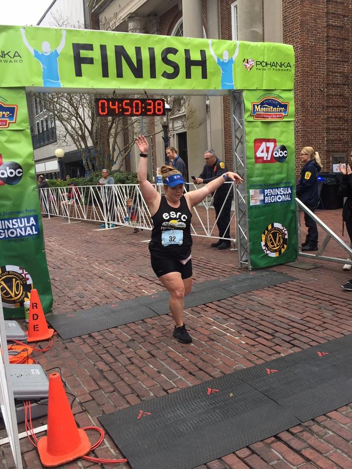Vanessa Junkin puts her hands up as she finishes the Salisbury Marathon.