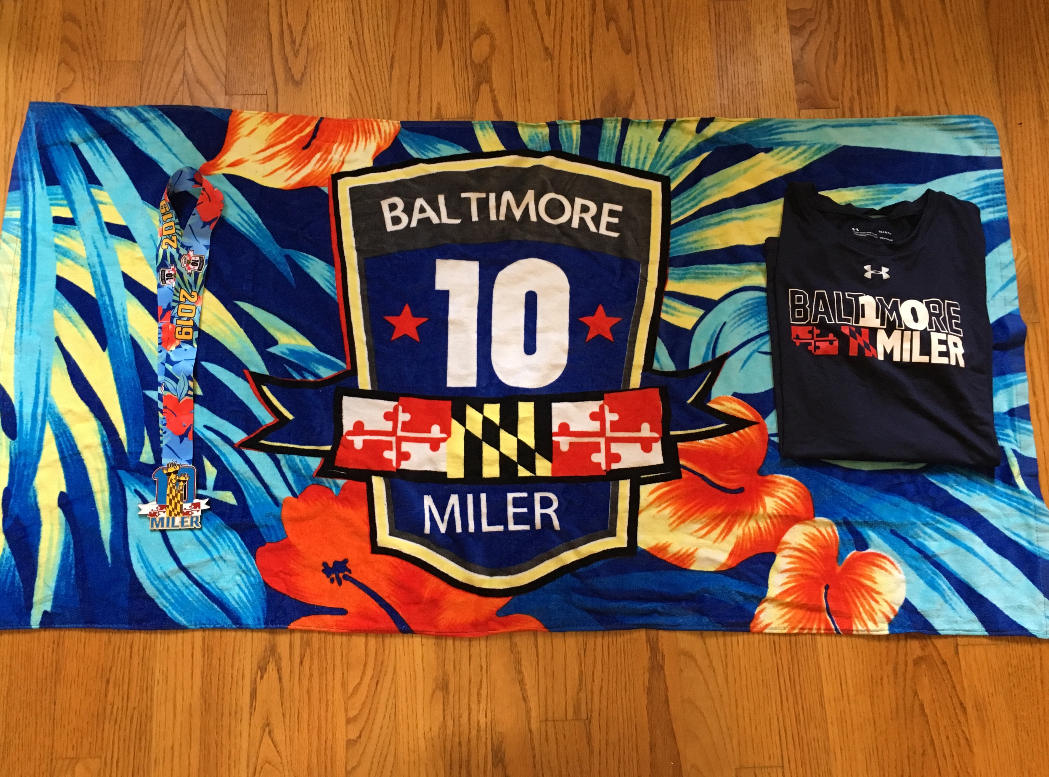 Baltimore 10 Miler swag: Beach towel, shirt and medal