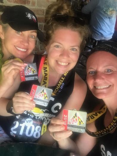 Vanessa Junkin, center, and friends Veronica and Lynn, hold finisher medals in a selfie.