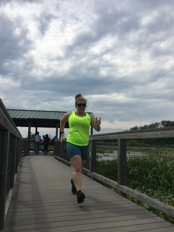 Vanessa Junkin running on Tinicum Marsh Boardwalk