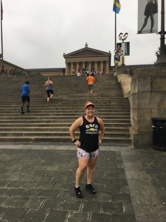 Vanessa Junkin poses in front of the Rocky Steps at the Philadelphia Museum of Art.