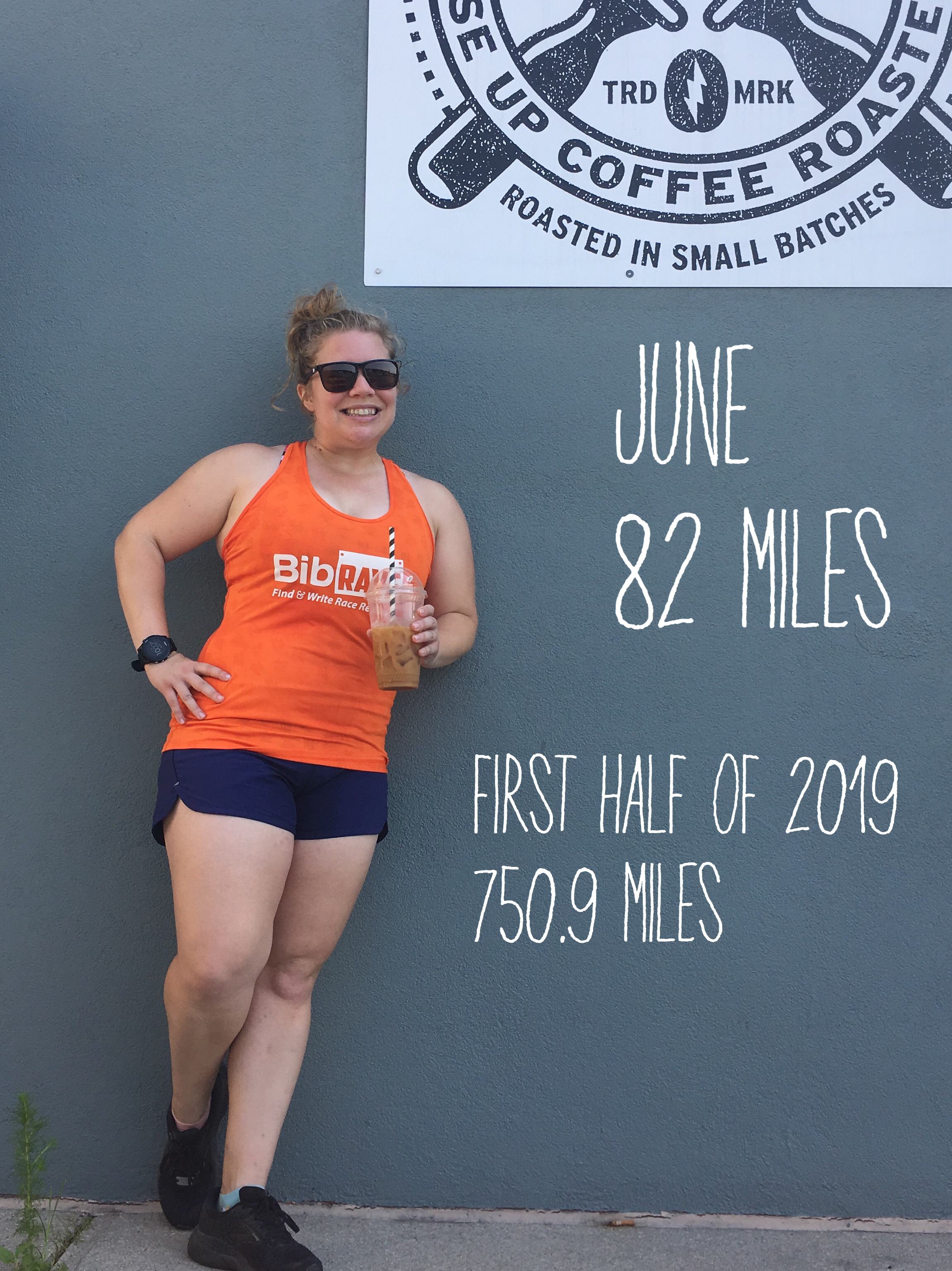 Vanessa Junkin stands outside of Rise Up Coffee. Text on photo reads: June 82 Miles; First Half of 2019: 750.9 Miles