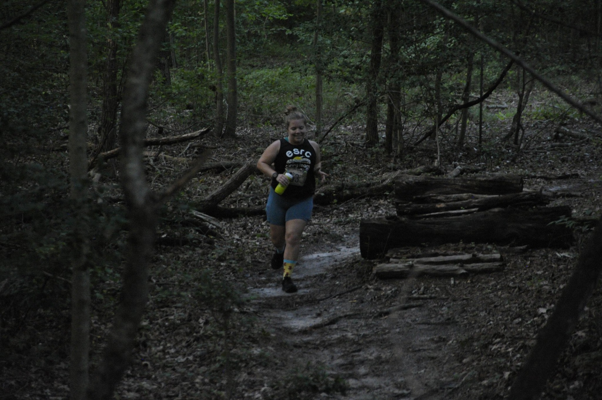 Vanessa Junkin running on a trail at the Naylor Mill 7K.