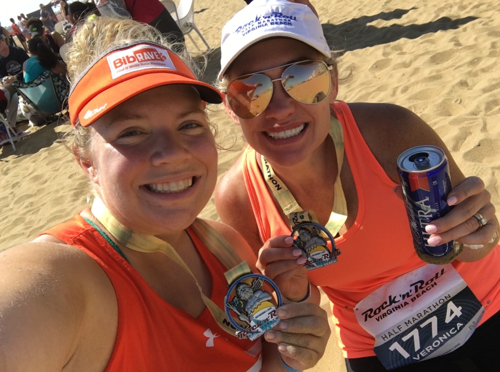 Vanessa Junkin and her friend Veronica posing for a selfie with their finisher medals.
