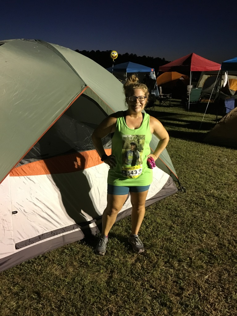 Vanessa Junkin poses in front of her tent at the Pemberton 24.