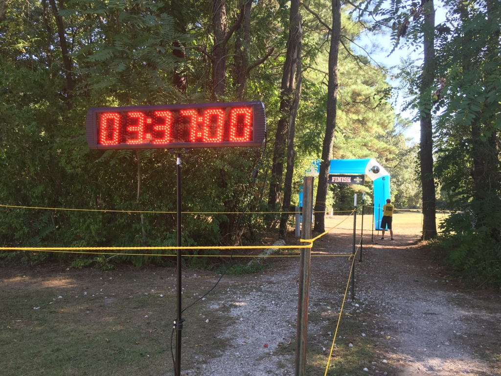 Countdown clock showing 3:37:00 with the finish arch in the background.