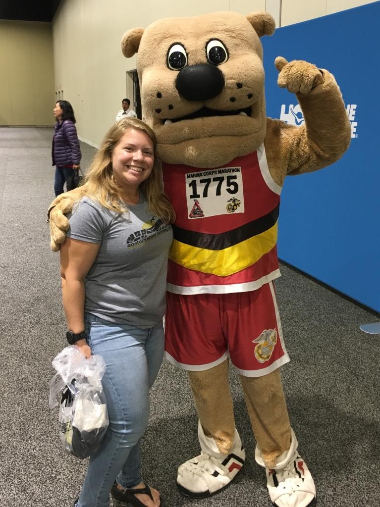 Vanessa Junkin posing with Marine Corps mascot