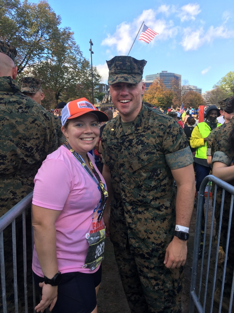 Vanessa Junkin poses with the Marine who gave her a finisher medal.