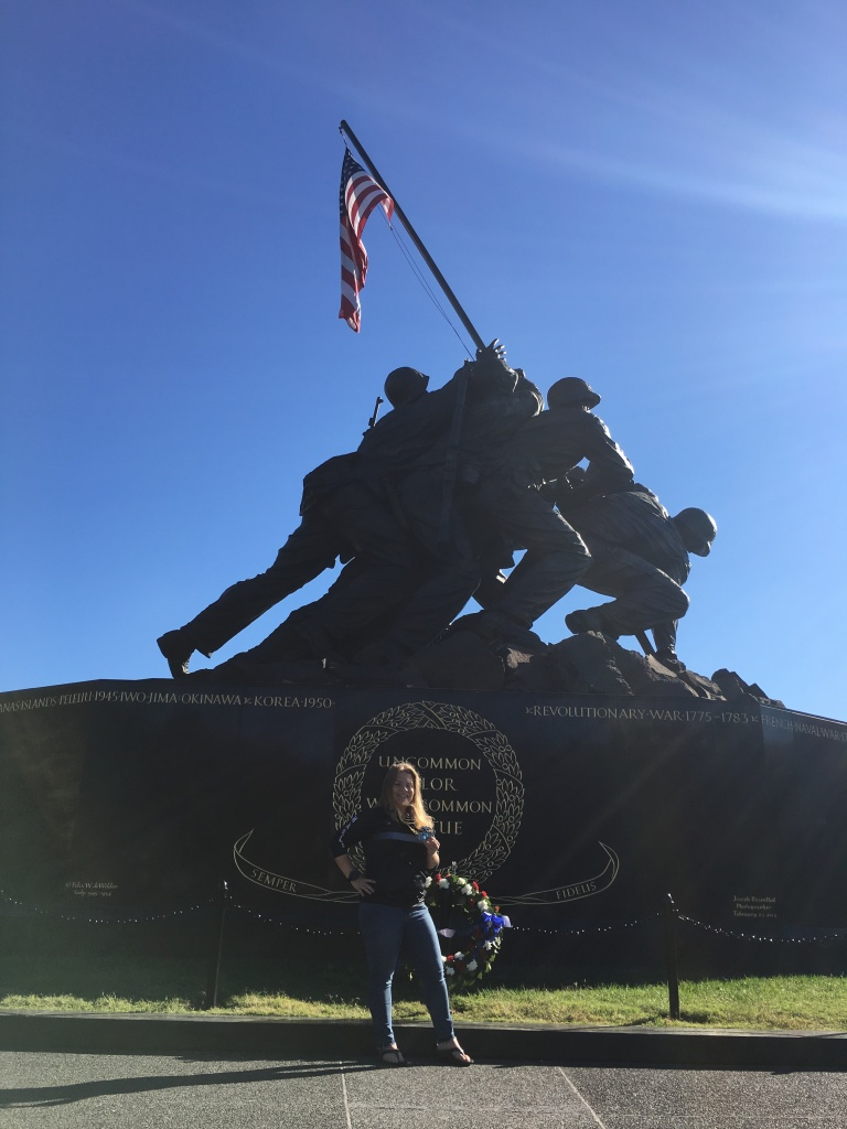 Vanessa Junkin poses in front of the U.S. Marine Corps War Memorial.