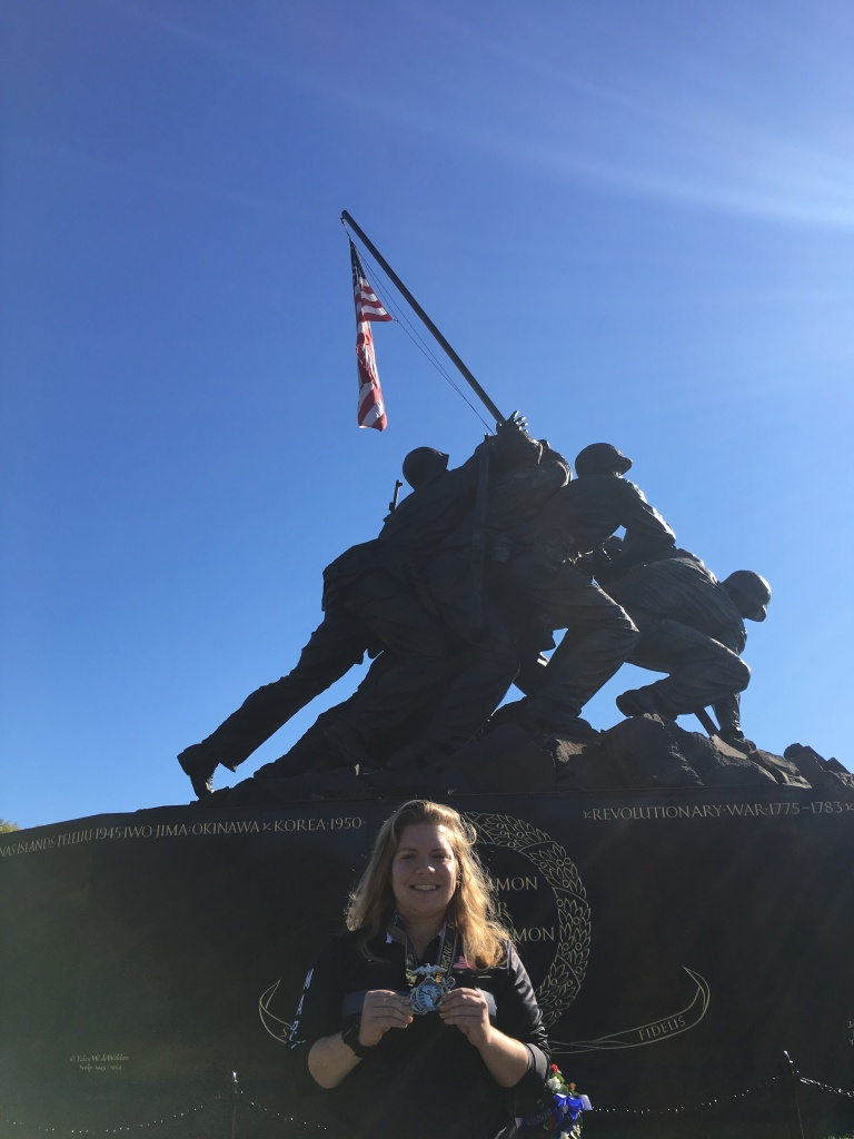 Closer photo of Vanessa Junkin posing in front of the U.S. Marine Corps War Memorial.