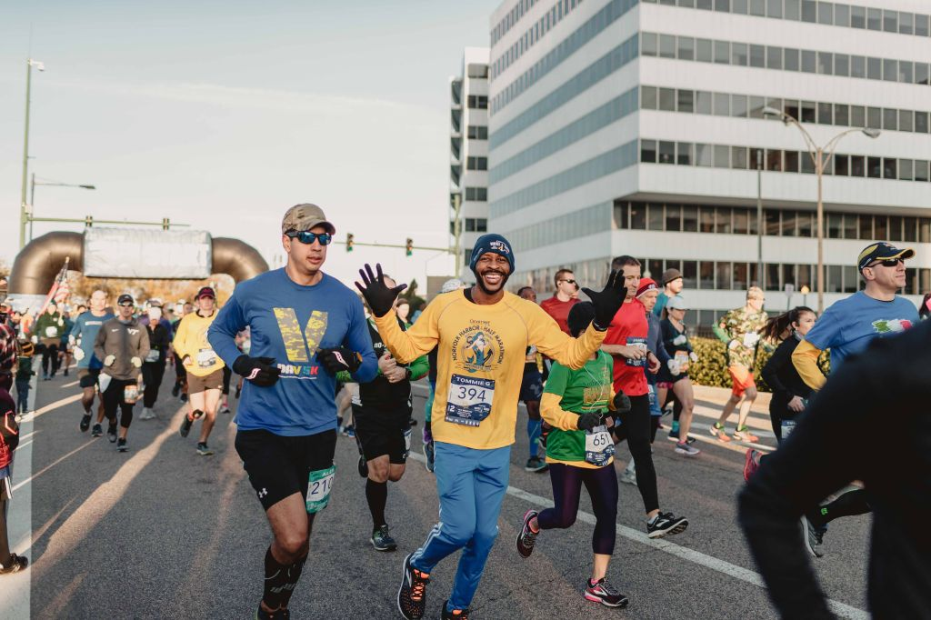 People running the Norfolk Harbor race - runner in center is especially happy