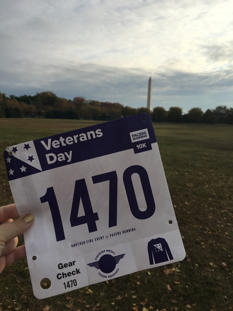 Vanessa Junkin's race bib (1470) for the Veterans Day 10K, with the Washington Monument in the background.