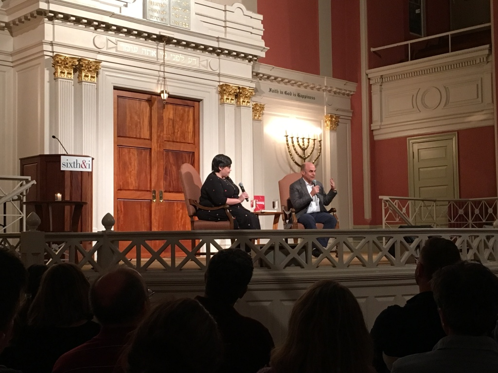 Peter Sagal, right, talks as Linda Holmes moderates at the Sixth & I Historic Synagogue.