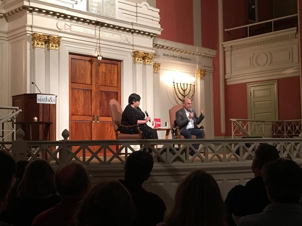 Peter Sagal, right, talks as Linda Holmes moderates at the Sixth & I Historic Synagogue.