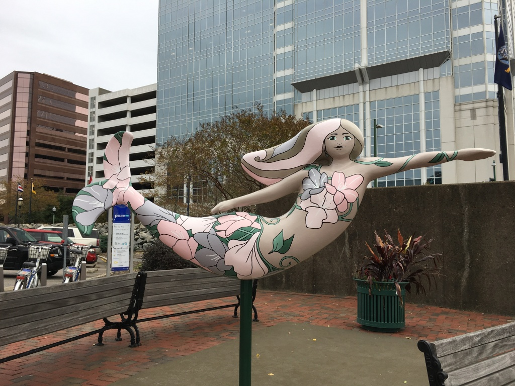 Mermaid sculpture painted with flowers in Norfolk.