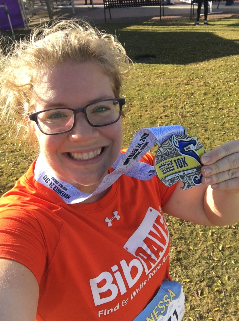 Vanessa takes a selfie with her finisher medal.