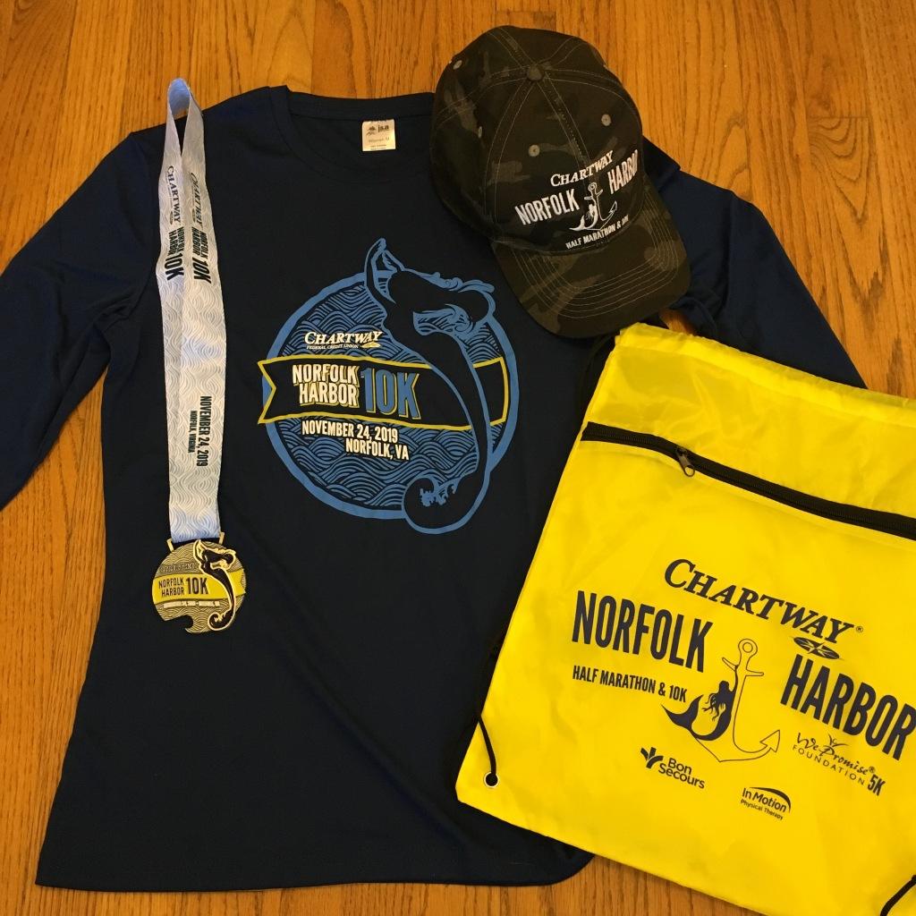 Norfolk Harbor 10K swag: Long-sleeved tech shirt, hat, medal and drawstring bag.