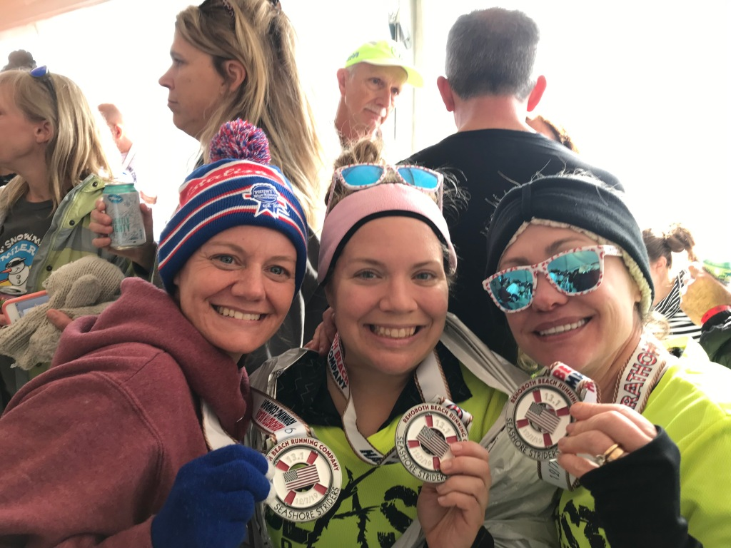 Lynn, Vanessa and Veronica pose with their race medals.