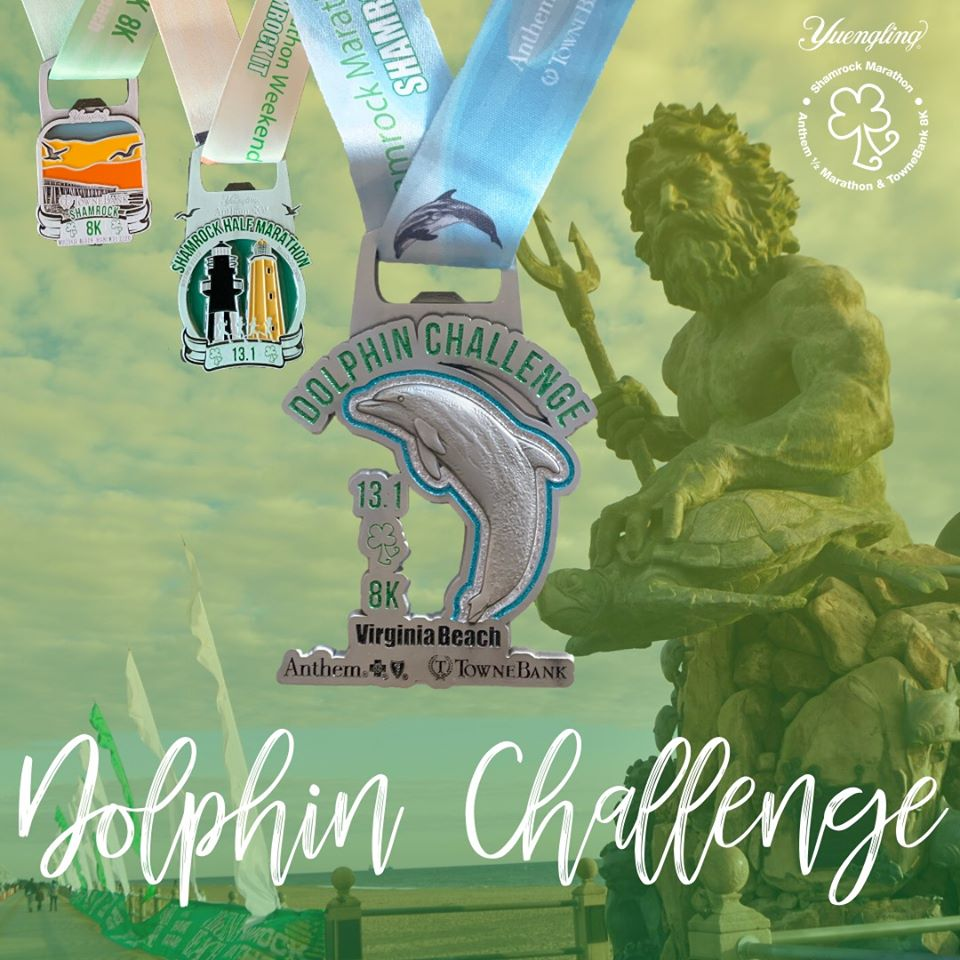 Photo from the Yuengling Shamrock Marathon Weekend Facebook page showing the Dolphin Challenge Medal, and the half marathon and 8K medal in the background, with an image of the King Neptune statue.