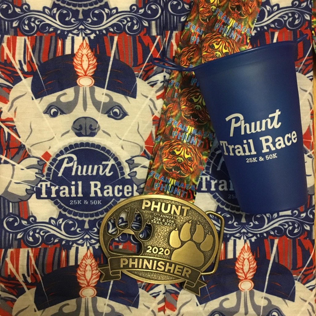 "PHUNT Buff, reusable cup and ""Phuckle,"" which is a medal/buckle."