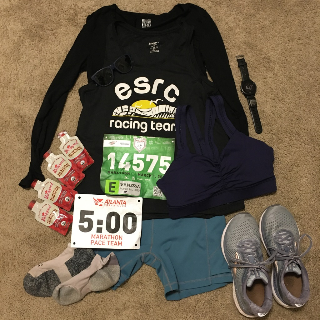 Race outfit, gels, shoes, socks, race bib, pace time bib and watch set out before race day.