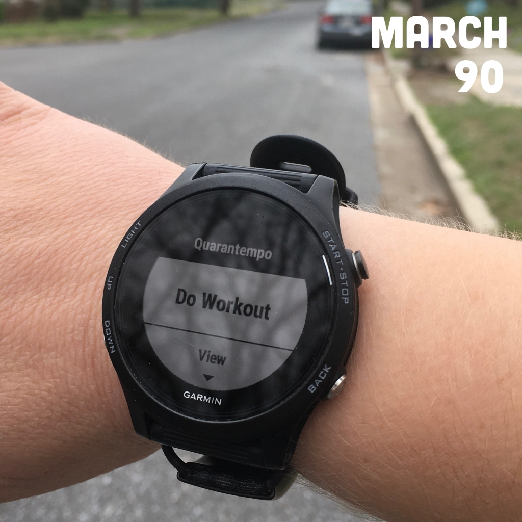"Photo of watch on wrist showing ""Quarantempo,"" ""Do Workout"" and ""View."" Text says ""March 90,"" for 90 miles in March."