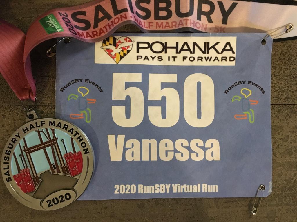 Race bib and medal for the virtual Salisbury Half Marathon