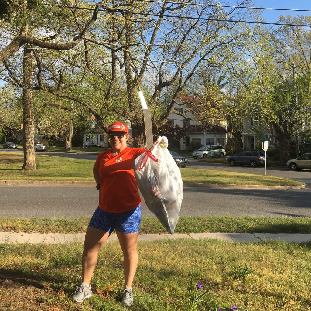 Vanessa Junkin poses with a bag of trash.