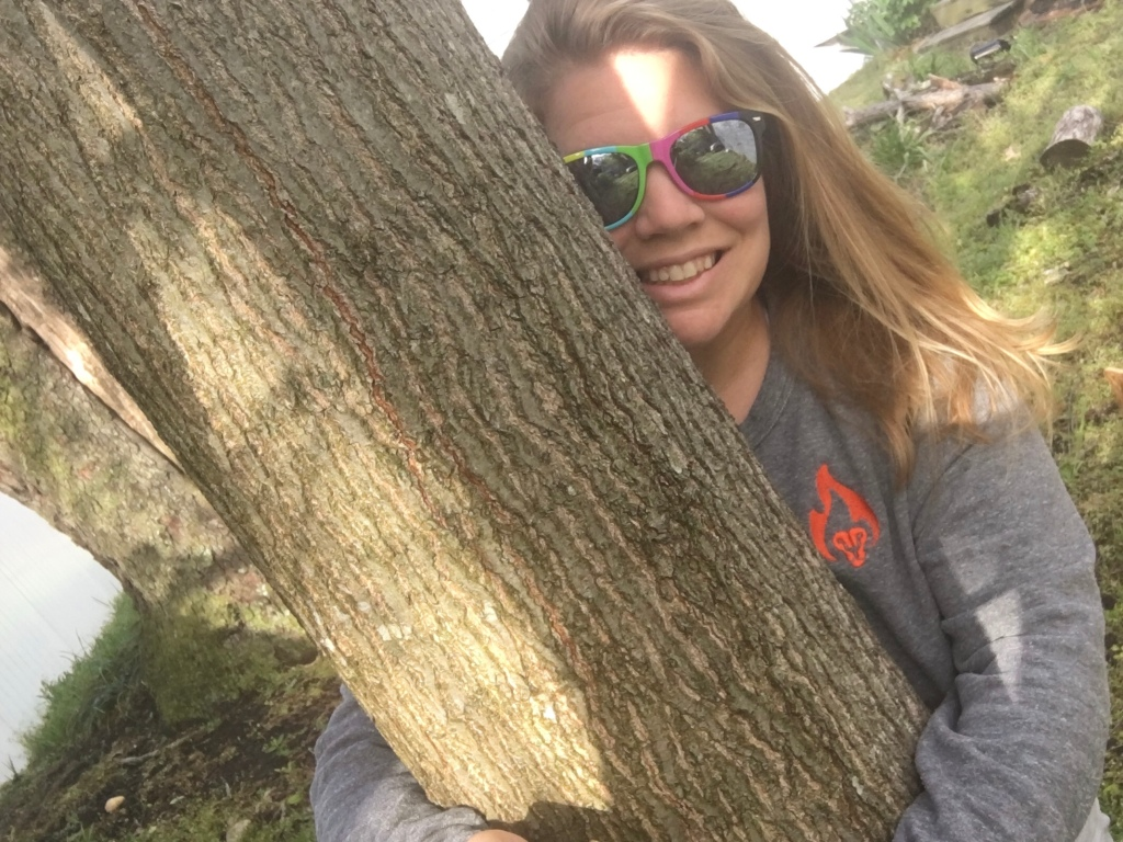 Selfie of Vanessa Junkin hugging a tree.