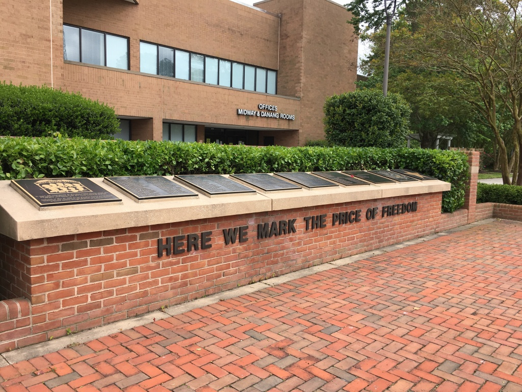 "Wicomico War Veterans Memorial outside the Wicomico Civic Center. The memorial reads, ""Here we mark the price of freedom,"" with plaques above."