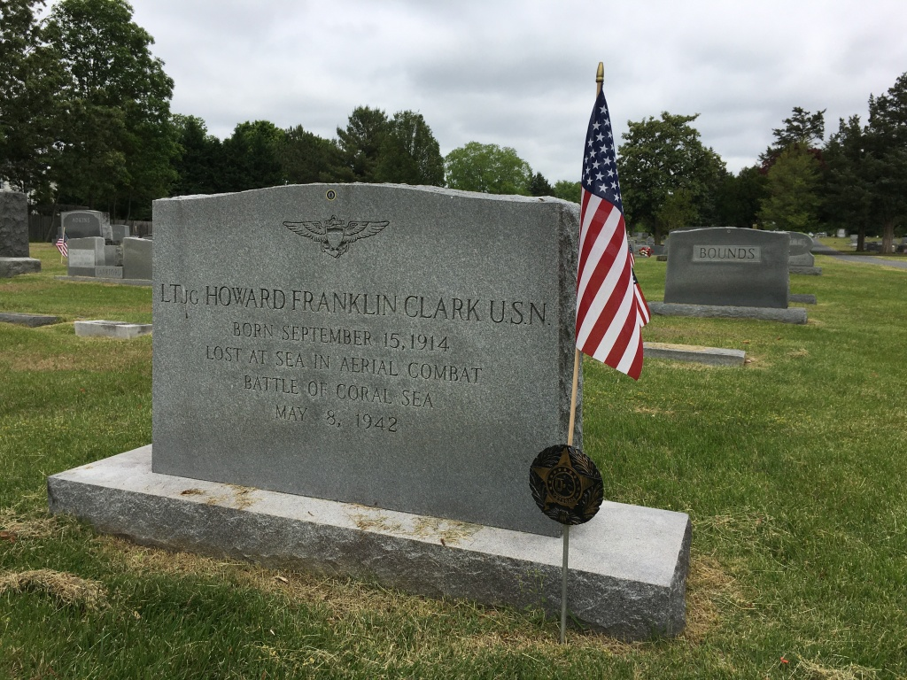 A grave with an American flag by it:  It reads:  LTJG Howard Franklin Clark USN Born September 15, 1914  Lost at Sea in Aerial Combat Battle of Coral Sea May 8, 1942