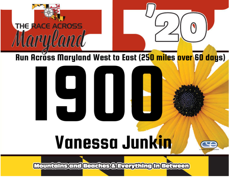 Race bib for Race Across Maryland, showing race logo, '20, bib number 1900 and name, Vanessa Junkin.