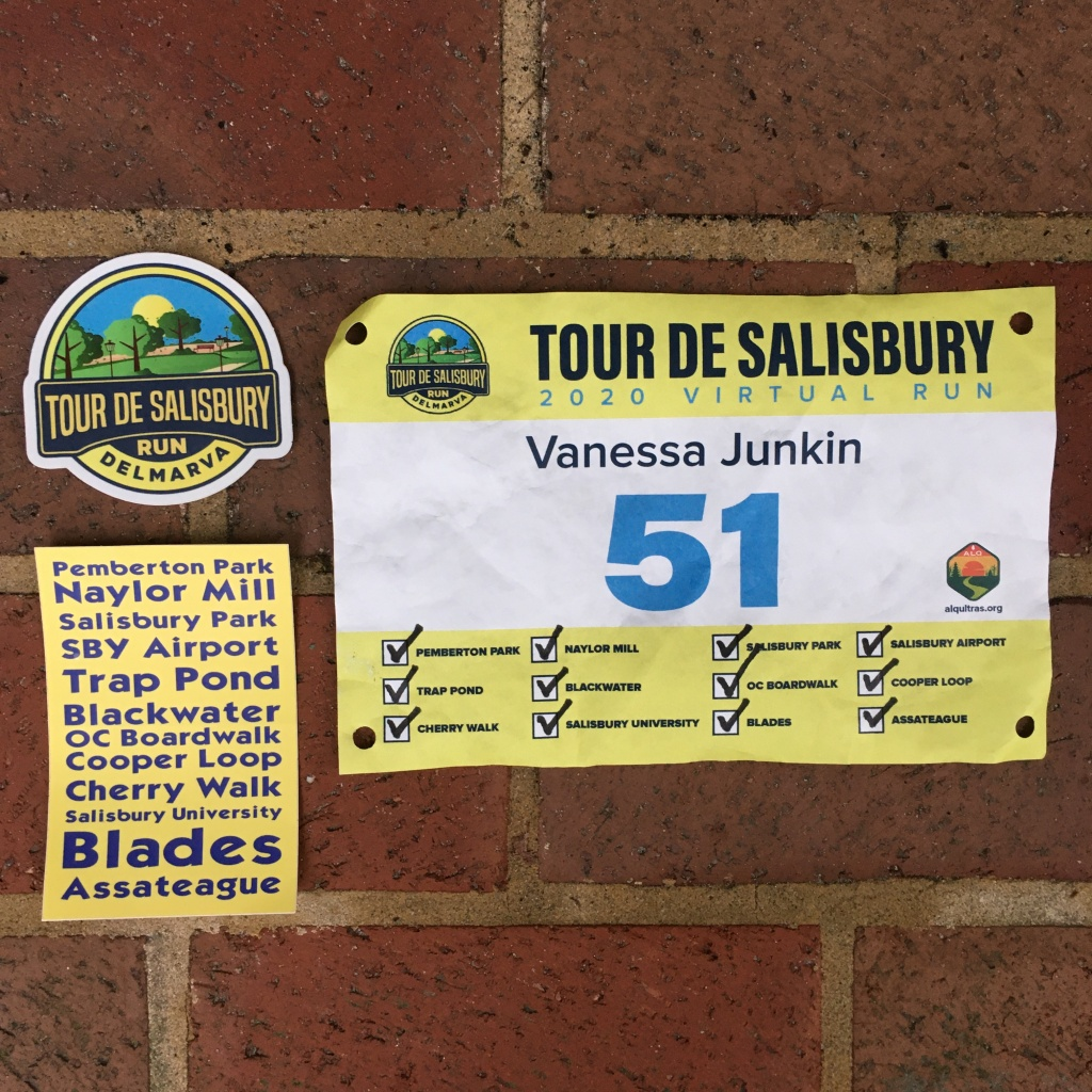 Race bib with all the segments checked off on the right, with Tour de Salisbury stickers on the left. The top sticker is the event logo and the bottom one lists all the segments.