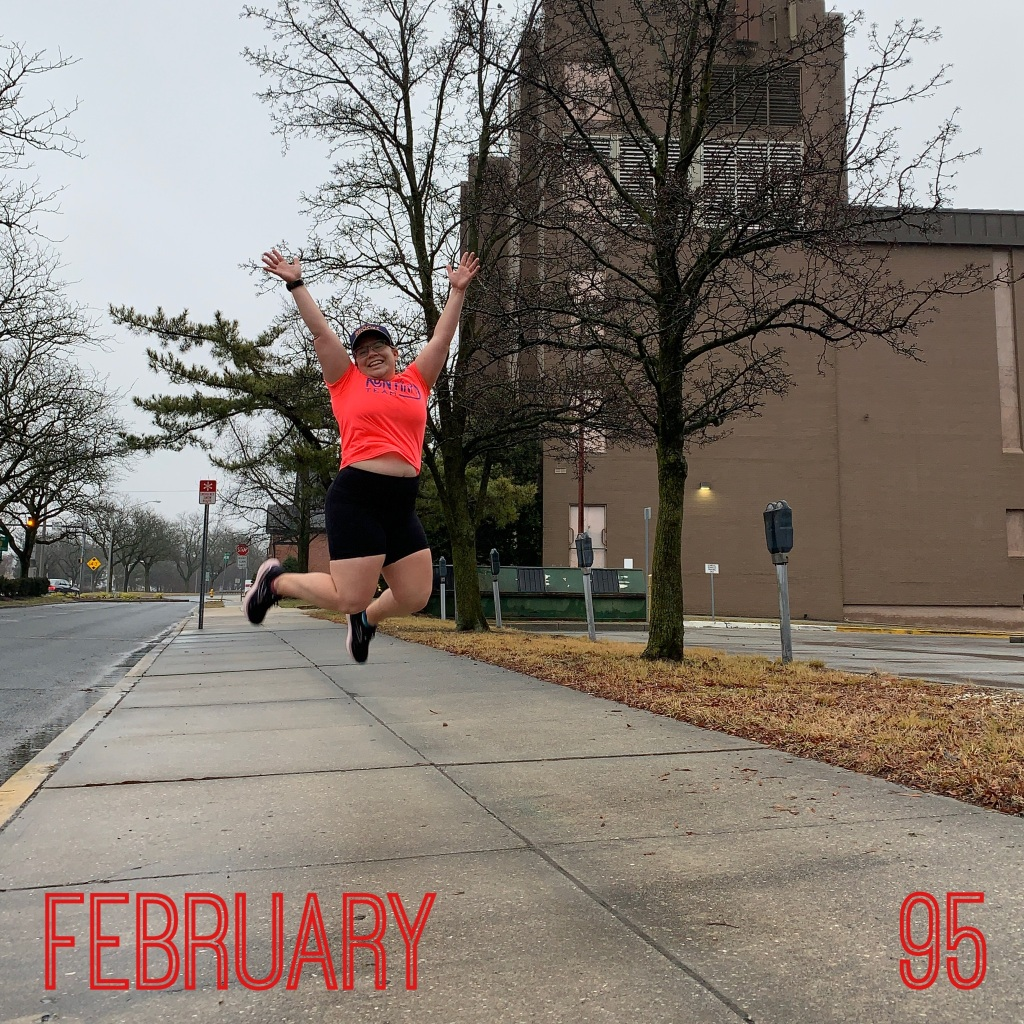 "Female runner jumping from a sidewalk with her arms raised. Text reads ""February"" and ""95."""