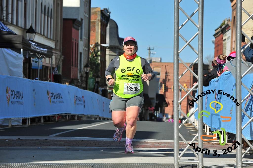 Female runner finishing the Salisbury Half Marathon.