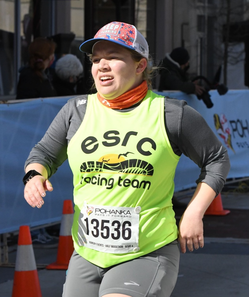 Front/side close-up view of female runner finishing the Salisbury Half Marathon.