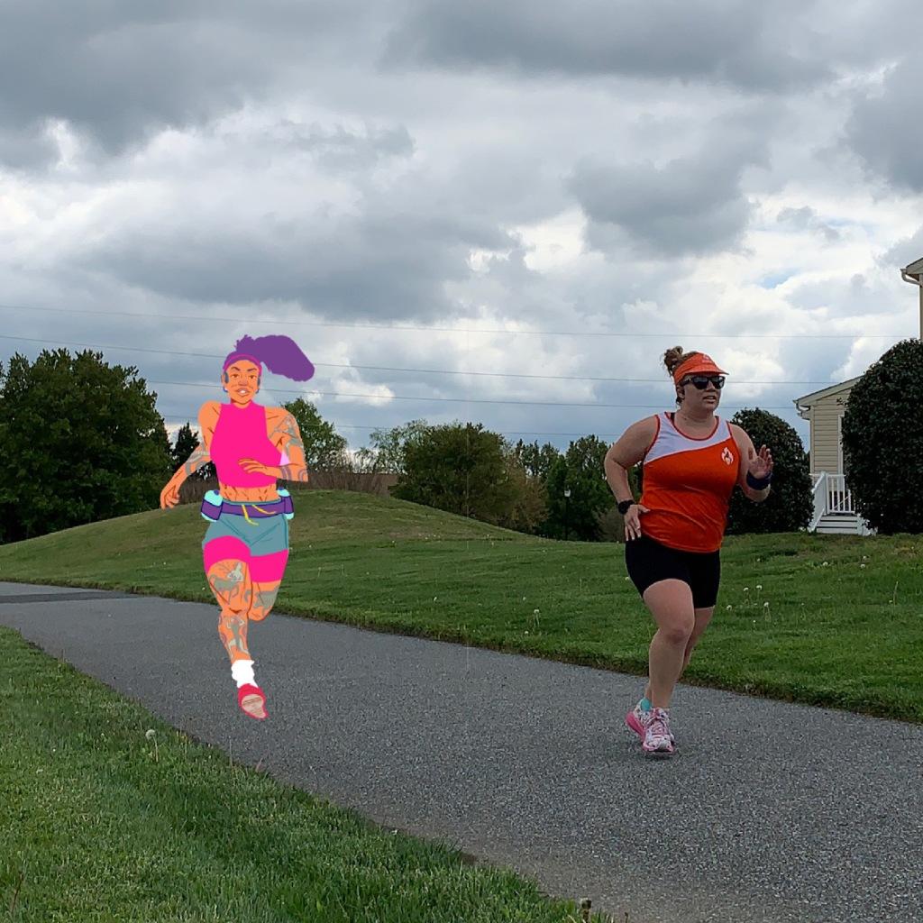 Vanessa Junkin running with a cartoon image of Atalanta, Goddess of Running, in the photo.