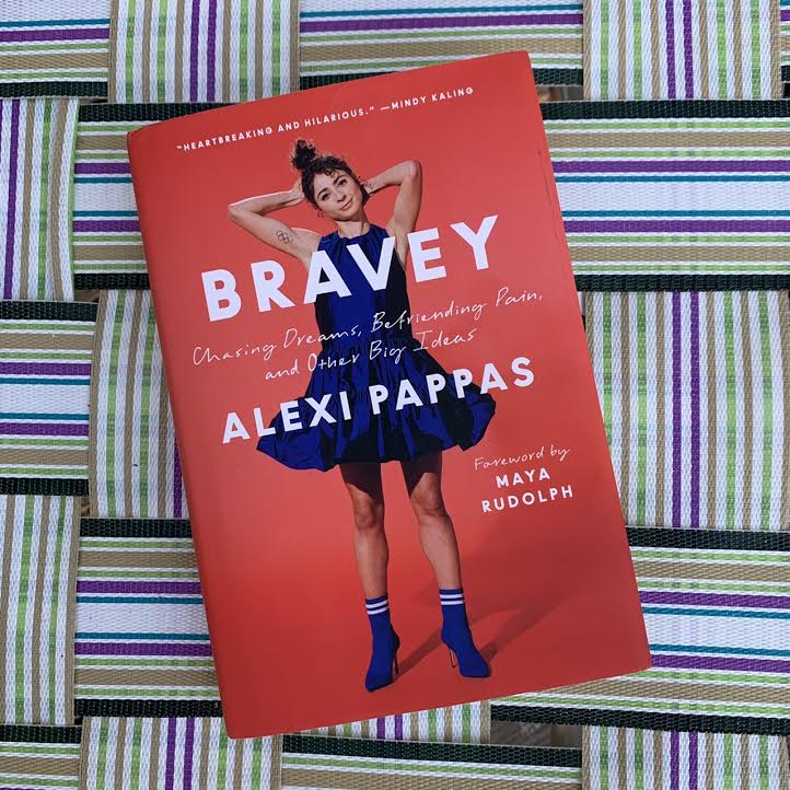 """""""Bravey"""" book by Alexi Pappas against the background of a lawn chair."""