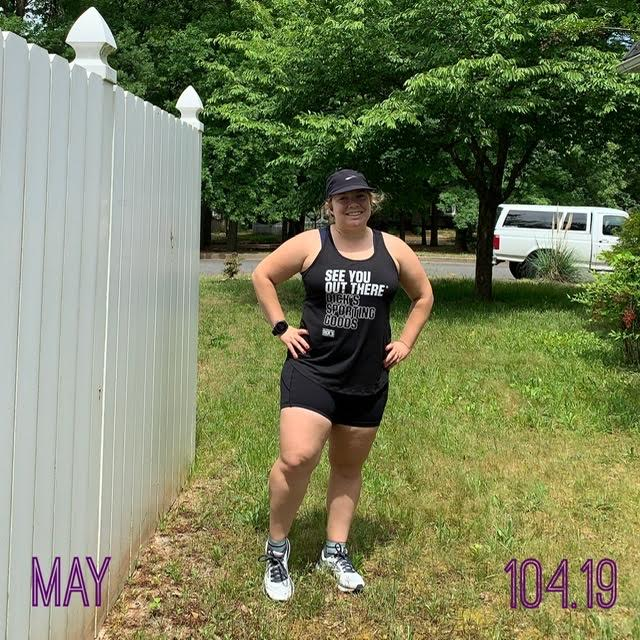 """Vanessa Junkin posing in black tank top, shorts and hat. Text reads """"May"""" and """"104.19"""" for 104.19 miles."""
