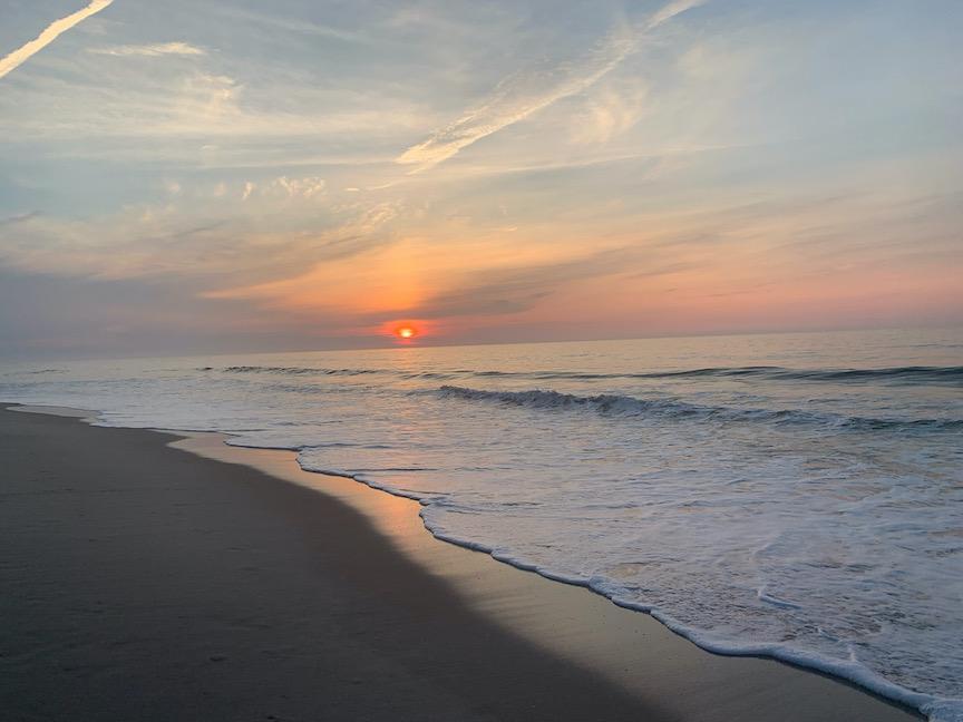 Sun rising over the ocean at Assateague.