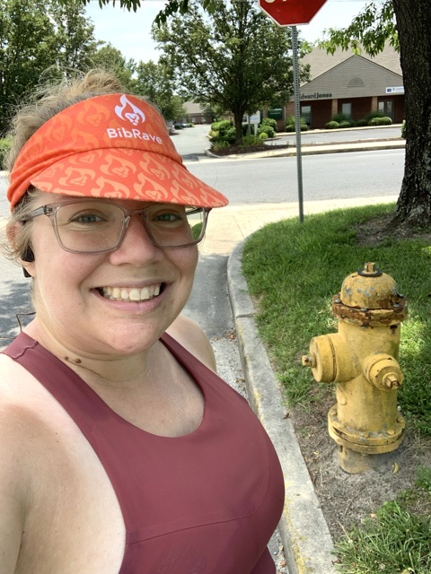 Selfie of Vanessa Junkin posing with fire hydrant.