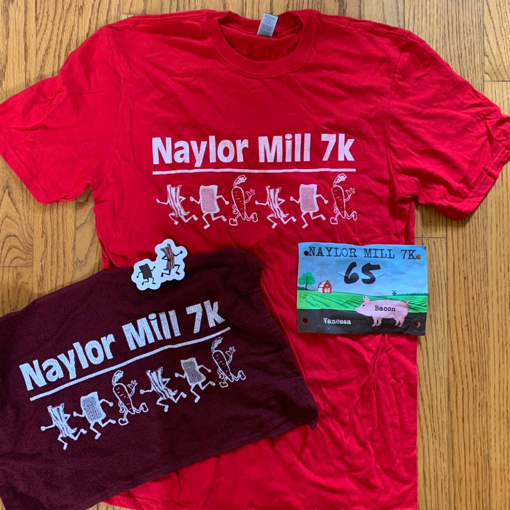 Race swag: T-shirt, towel, sticker and bib.